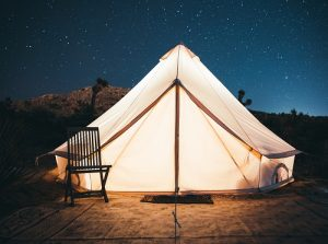 Sturdy canvas tent in picturesque night time outdoor setting